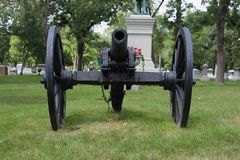 A Civil War Black Canon in a Cemetery royalty free stock photo