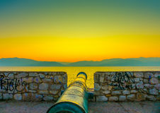 The Canon. Canon over a stone made wall in Nafplio city in Greece stock photography