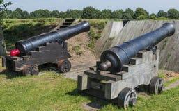 Canon på fästningen Bourtange Royaltyfri Fotografi