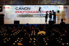 Canon photomarathon asia (singapore). Singapore leg of the photo competition event held across Asia. This picture, local deejays entertains the meagre crowd as Stock Image