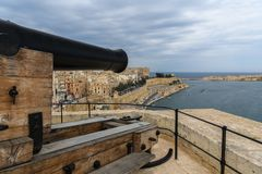 Canon pointing over Valetta Harbor in Malta. Historical Canon pointing over Valetta Harbor in Malta, Europe Royalty Free Stock Image