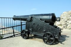 Canon Pointing to Spain from Gibraltar. Scenes from the Rock of Gibraltar on the south coast of Spain Stock Image
