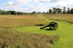 Canon set in meadow where wars were fought. Old, historic canon set in silent meadow where wars were fought years ago stock image