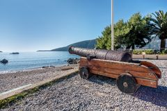 Canon by the Statue of king Stephen Tvrtko I in port of Herceg. Novi, Montenegro royalty free stock photography