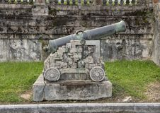 Canon beside the steps to the terrace of the garden of the Forbidden city, Imperial City, Citadel, Hue, Vietnam. Pictured is a canon beside the steps to terrace royalty free stock photos