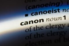 Canon. Word in a dictionary.  concept Royalty Free Stock Image