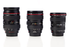 Canon zoom lenses. Canon, EF 17-40 4L, 24-70 2.8L, 24-105 4L IS, zoom lenses isolated on white royalty free stock images