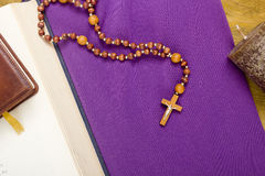 Free Canonical Crucifix On The Purple Fabric Royalty Free Stock Photos - 64272528