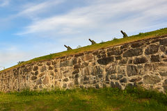 Canons on stone wall Royalty Free Stock Photos