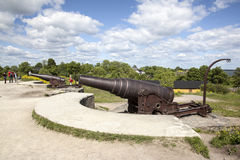 Canons and tourists on the fortification island suomenlinna Royalty Free Stock Photography