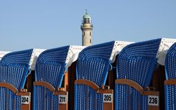 Canopied beach chairs with light tower Stock Images