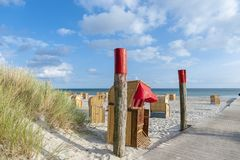 Beach chairs in Burgtiefe. Canopied wicker beach chairs on the South beach in Burgtiefe on the island Fehmarn at the Baltic Sea Stock Photography