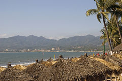 Canopies on tropical beach stock photo