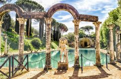 The Canopus, ancient pool in Villa Adriana, Tivoli, Italy. The ancient pool called Canopus, surrounded by greek sculptures in Villa Adriana & x28;Hadrian& x27;s stock photography