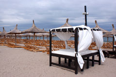 Canopy on beach. Relaxing on canopy on a windy beach stock image