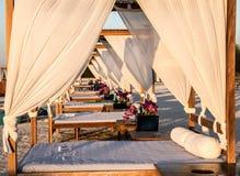 Canopy beach beds. Beach cabana for spa massage or for rest. Yas Beach. Yas Island Stock Photos