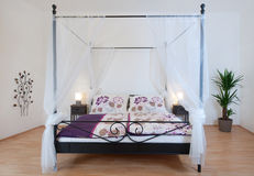 Canopy bed Stock Image