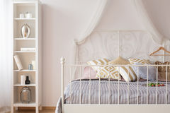 Canopy bed with metal headboard Royalty Free Stock Photos