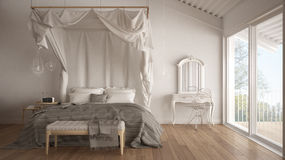 Canopy bed in minimalistic white bedroom with big window, scandi Royalty Free Stock Photography