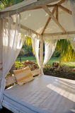 Canopy bed in tropical resort. Tropical canopy bed in gardens Royalty Free Stock Image