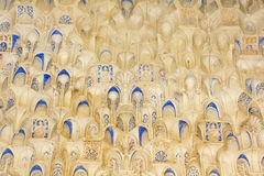 Canopy with stonework. Hall of the two Sisters in Alhambra. Gran. Canopy with stonework. Arabesques made with Arabic calligraphy. Hall of the two Sisters. The Royalty Free Stock Photo