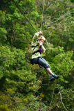 Canopy Tour. Woman on a zip line in panama canopy Royalty Free Stock Image