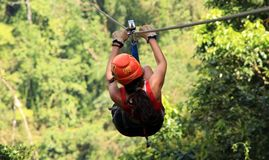 Canopy zip lining tirolesa in Costa Rica Tour Beautiful Girl. In adventure stock images