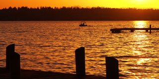 Canottaggio al tramonto Fotografie Stock