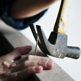 Canpenter using hammer pull a nail out from a wood Royalty Free Stock Photos