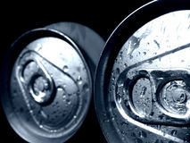Cans. Detailed closeup of wet drink cans Royalty Free Stock Photo