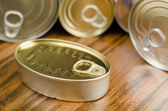 Cans. Can on wood table wth others out of focus Royalty Free Stock Photos