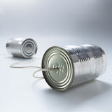 Cans. Two tin cans connected by a piece of string royalty free stock photos