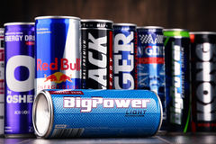 Cans of assorted global energy drink products. POZNAN, POL - JUL 27, 2017: global market of energy drinks containing stimulant drugs and marketed as providing Stock Image