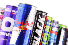 Cans of assorted global energy drink products. POZNAN, POL - JUL 27, 2017: global market of energy drinks containing stimulant drugs and marketed as providing Royalty Free Stock Photo