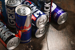 Cans of assorted global energy drink products. POZNAN, POL - JUL 27, 2017: global market of energy drinks containing stimulant drugs and marketed as providing Royalty Free Stock Images