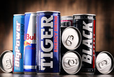 Cans of assorted global energy drink products. POZNAN, POL - JUL 27, 2017: global market of energy drinks containing stimulant drugs and marketed as providing Stock Images