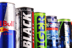 Cans of assorted global energy drink products. POZNAN, POL - JUL 27, 2017: global market of energy drinks containing stimulant drugs and marketed as providing Royalty Free Stock Photography