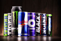 Cans of assorted global energy drink products. POZNAN, POL - JUL 27, 2017: global market of energy drinks containing stimulant drugs and marketed as providing Stock Photography