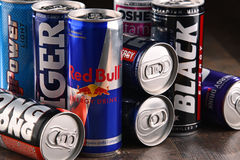 Cans of assorted global energy drink products. POZNAN, POL - JUL 27, 2017: global market of energy drinks containing stimulant drugs and marketed as providing Royalty Free Stock Image