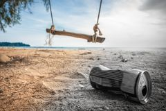 Cans on the beach destroy the environment. Garbage in the sand on nature. trash on on a beautiful beach with a swing stock image
