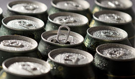 Cans of Beer. With selective focus on center opened can Royalty Free Stock Image