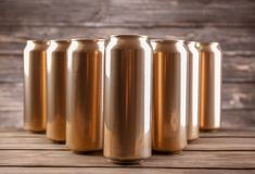 Cans of beer. On wooden background stock image