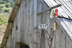 The cans of the beer hanging from the mountain hut royalty free stock photo