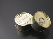 Cans  on black background Royalty Free Stock Images