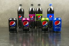 Cans and bottles with different types of Pepsi original, max, lime, wild cherry. stock images