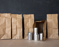 Cans and Brown Bags Royalty Free Stock Photo