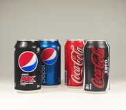 Cans of Coke and Pepso. Brisbane, Australia - June 12th, 2014: Photo of a Coca-Cola and Pepsi cans. Coca-cola and Pepsi are among the most popular carbonated Royalty Free Stock Photo
