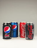 Cans of Coke and Pepso. Brisbane, Australia - June 12th, 2014: Photo of a Coca-Cola and Pepsi cans. Coca-cola and Pepsi are among the most popular carbonated Stock Photography