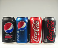 Cans of Coke and Pepso. Brisbane, Australia - June 12th, 2014: Photo of a Coca-Cola and Pepsi cans. Coca-cola and Pepsi are among the most popular carbonated Royalty Free Stock Image