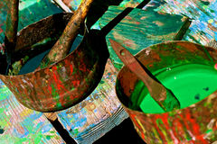 Cans of colorful paints on art table Stock Image